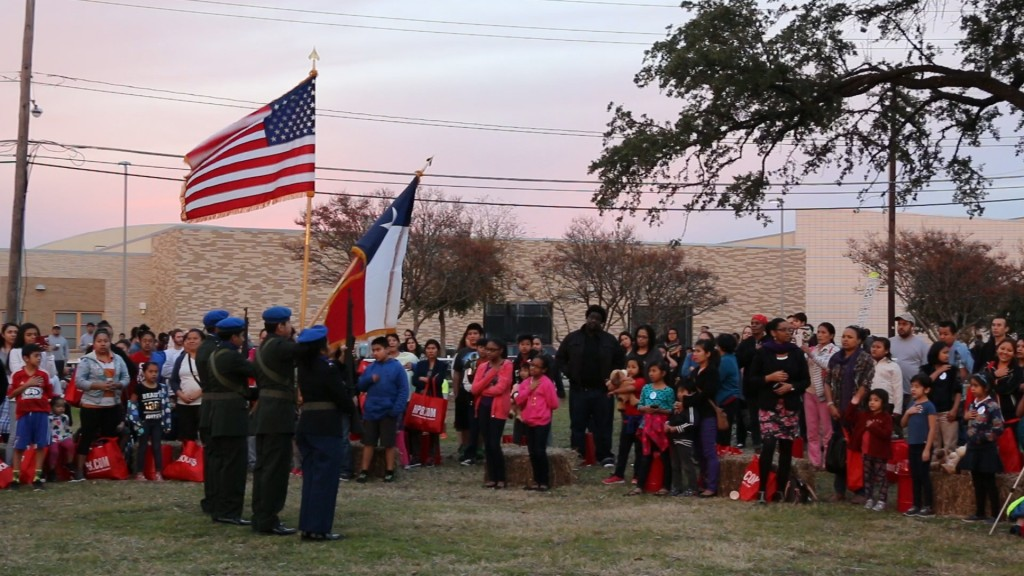 Dallas residents recite the pledge of allegiance at the 2015 Vickery Meadow Festival of Lights