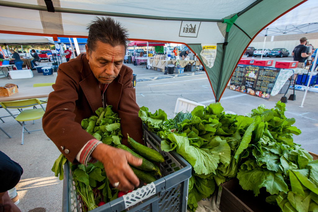 Gardeners in Dallas offer surplus yields at local farmers market