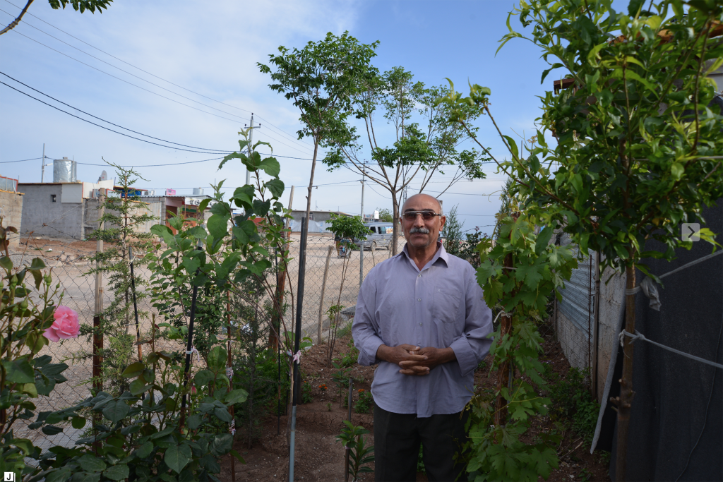 Gardener in Domiz camp, Iraq is pleased with his yield